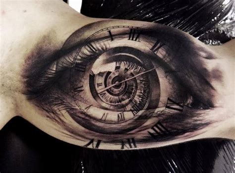Tattoo Fixers Eye Clock | tatouage bras horloge œil par tattoo studio 73