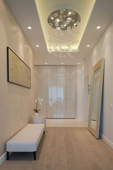 entry hall lighting details create drama in modern open plan apartment