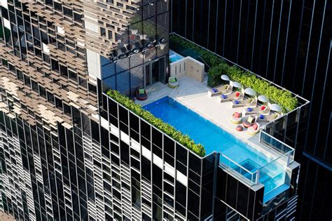 design and build procurement hong kong glass pool cantilevers from hong kong s hotel indigo by aedas