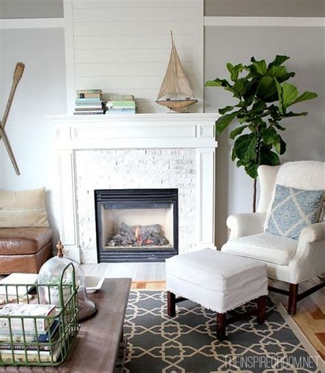paint colors for living rooms with brick fireplace plank wood above fireplace whitewashed brick whitewashed