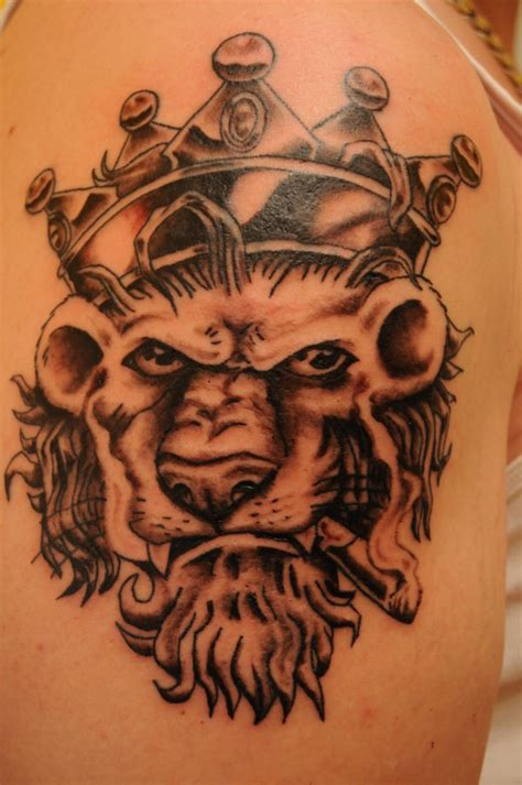 lion with a crown tattoo crown