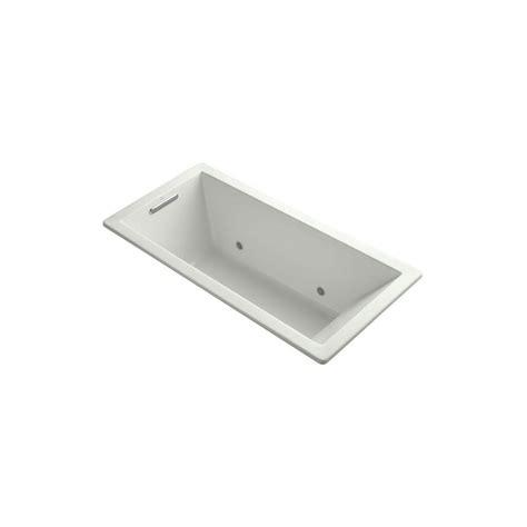 kohler underscore bathtub kohler underscore 5 5 ft reversible drain bathtub in dune