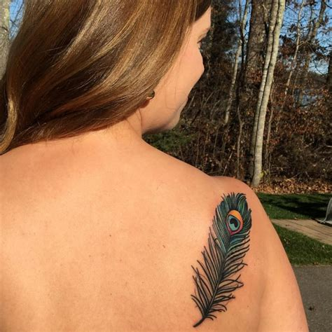peacock tattoo meaning 35 colorful peacock feather meaning designs 2019