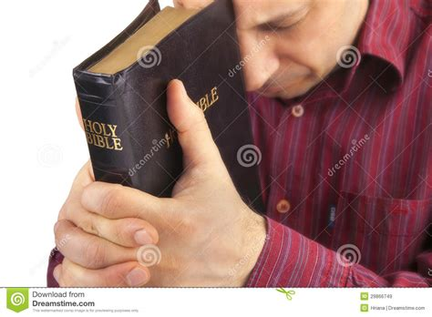 man holding man holding a bible royalty free stock photo