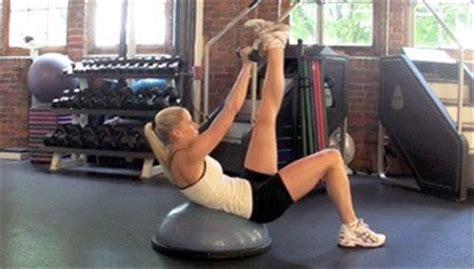 bosu single leg dumbbell crunch exercise