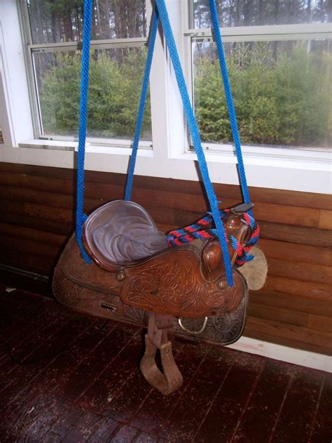 saddle swing my old saddle is now a saddle swing old boots horse