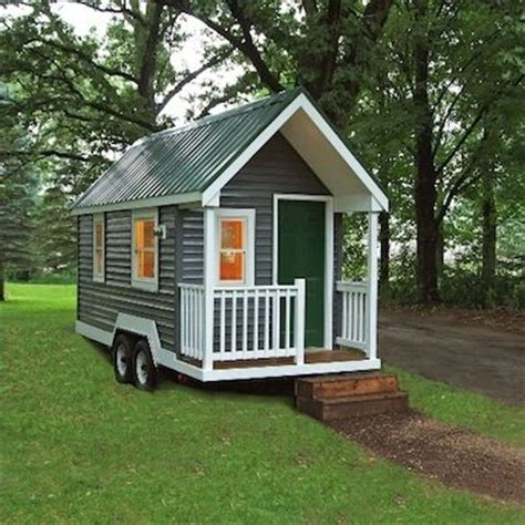 diy tiny house kits available in several easily transportable sizes the tiny green cabin is a