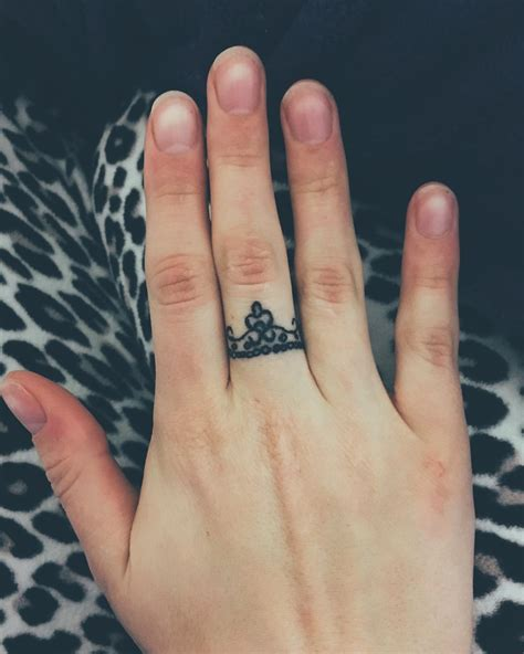 king crown tattoo on finger black ink simple crown finger tattoo design golfian com