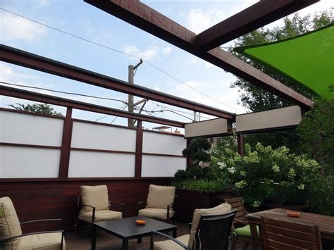roof deck pergola retractable shade urban landscape garden design outdoor dining lounge shade