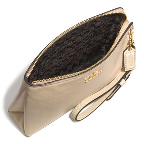 Coach Pouch coach large pouch wristlet in leather in beige light gold