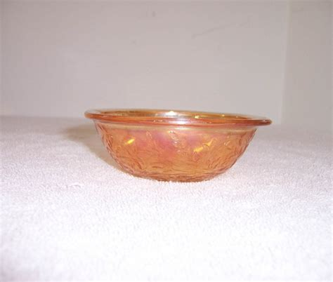triple a resale small marigold carnival glass bowl