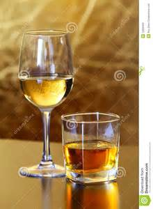 Vacation Home Plans glass of white wine and whiskey stock photos image 12269483
