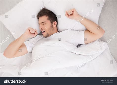 guy in bed young attractive man waking in morning handsome guy stretching and yawning in bed
