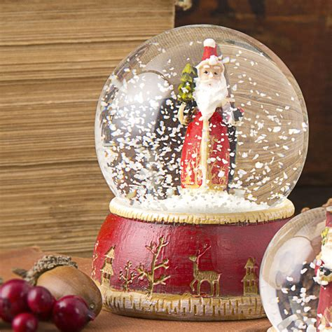 traditional santa snow globe by the christmas home