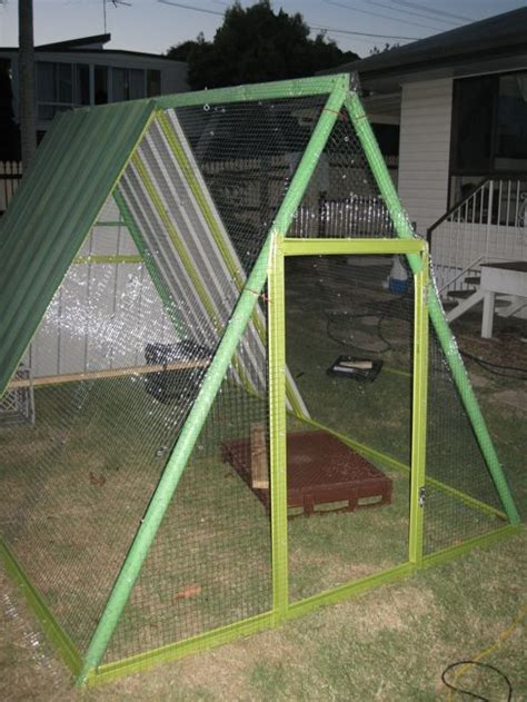 old swing set an old swing set frame turned into a diy chicken coop