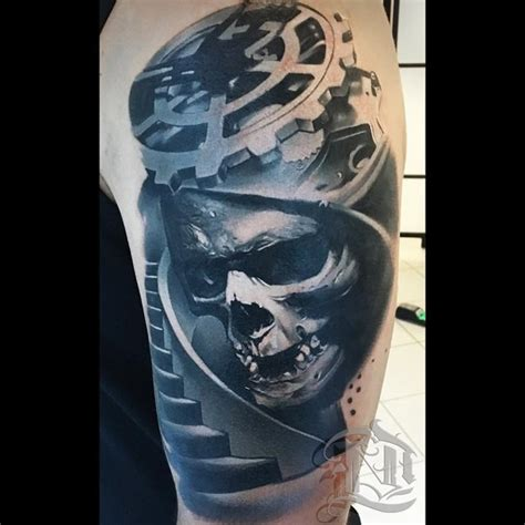 biomechanical lion tattoo creepy biomechanical style shoulder tattoo of human skull
