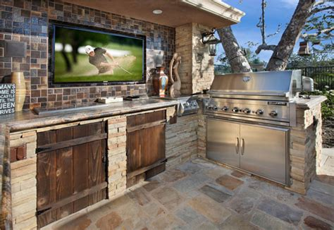 backyard tv outdoor kitchens and pizza ovens milanese remodeling