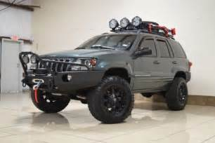 custom jeep grand overland 4x4 lifted tv dvd navi