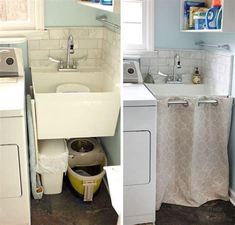under sink laundry her hidden storage under a laundry room sink
