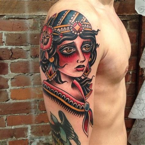 tattoo girl traditional girl upset traditional tattoo on the shoulder