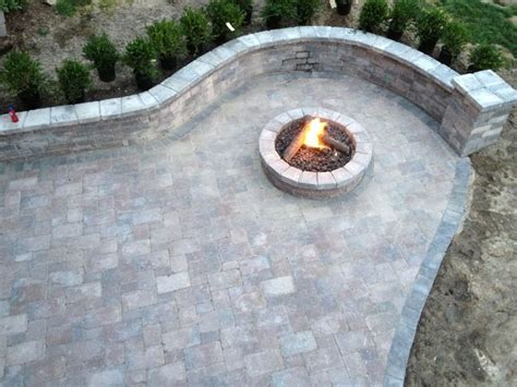 gas pit with tumbled unilock brick paver wall and