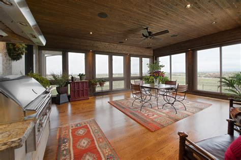 deck leads to four seasons room denbesten real estate 4 season sunroom with outdoor kitchen craftsman