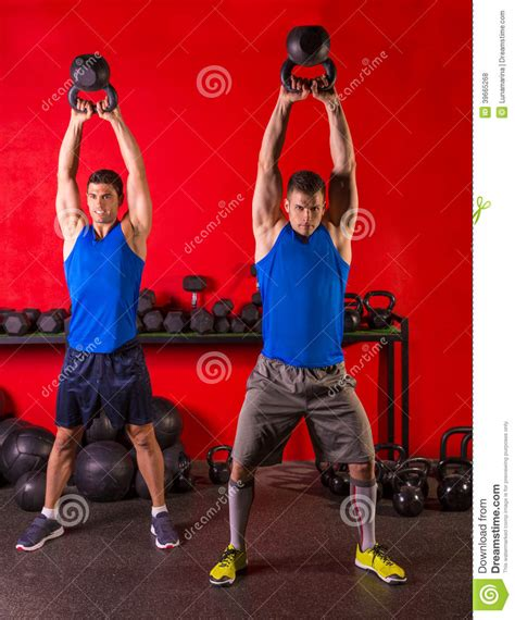 group swing kettlebell swing workout training group at gym stock photo
