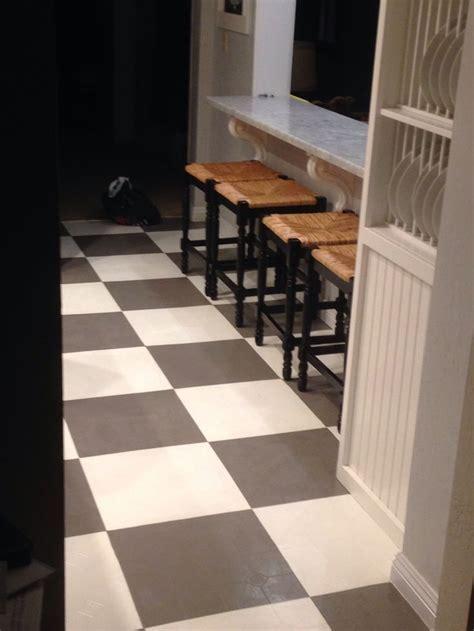 Checkerboard painted vinyl floor.   Kitchen stuff