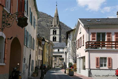 House With Tower the church of martigny view from the street switzerland