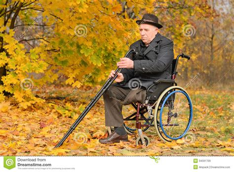 one leg wheelchair elderly disabled in his wheelchair royalty free stock