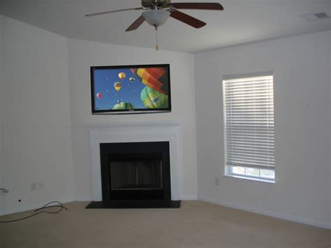 corner fireplace with tv above fireplaces