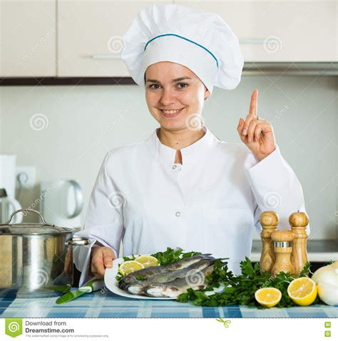 professional chef cooking fresh trout at kitchen stock photo image 72665450