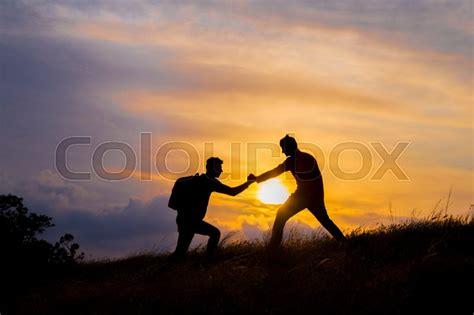teamwork couple hiking    trust assistance