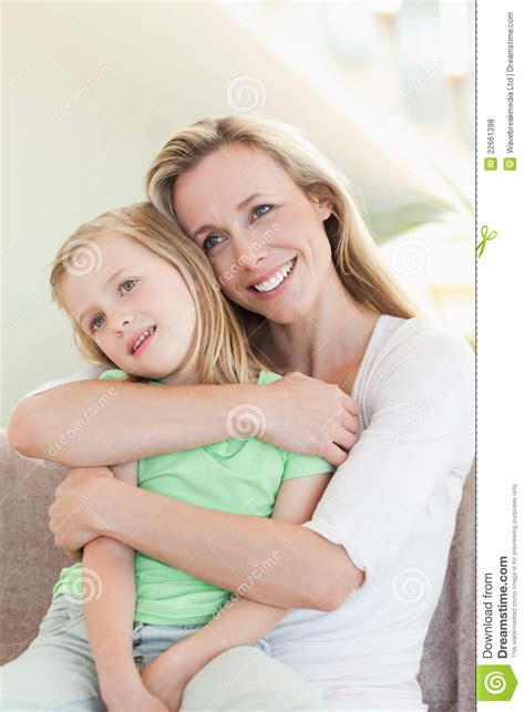 mom on sofa mother embracing daughter on sofa royalty free stock
