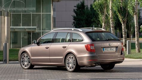skoda superb combi in brown outside the hotel hd wallpaper