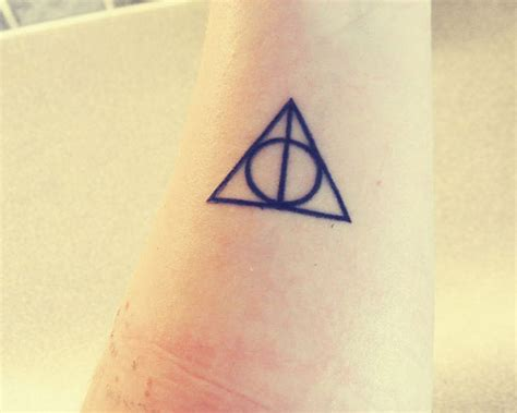 simple triangle tattoo simple triangle with deathly hallows of symbol