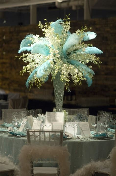 5 Things To Add To Your Xv Centerpieces To Make Them Pop Centerpieces With Feathers And Flowers