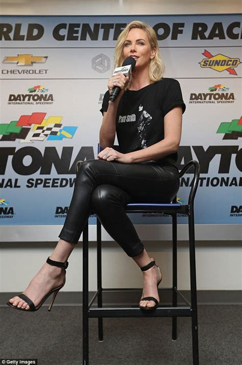Charlize Theron Got Rid Of The Black Do by Charlize Theron Rocks Skintight Leather At Nascar