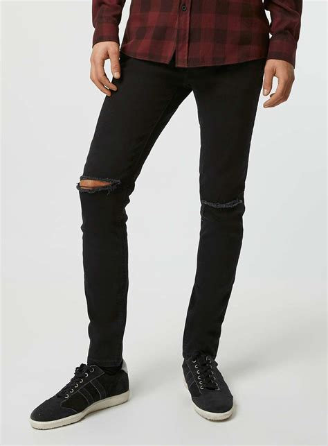 ripped cut knee black ripped knee ye jean