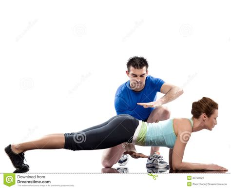man aerobic trainer positioning woman workout stock image