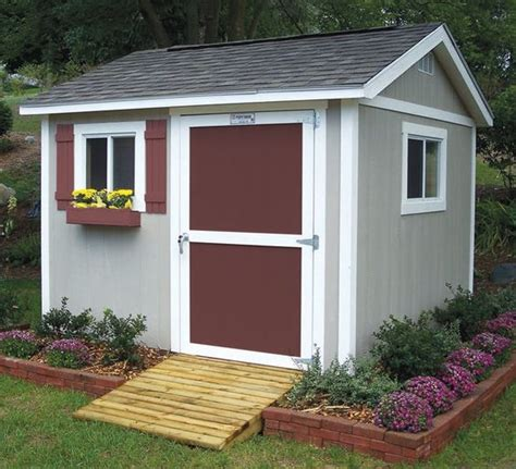 design your own shed home brick around shed with mulch and flowers gettin dirty