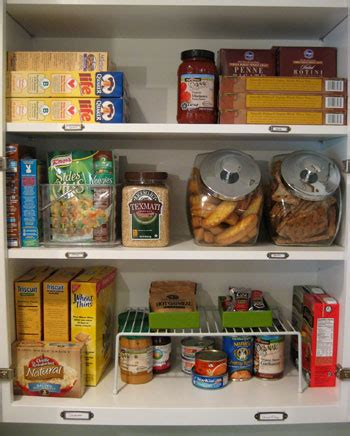 how to organize food in kitchen cabinets organizing our kitchen cabinets spices pantry items