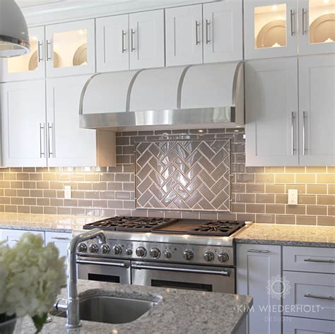 white and gray kitchen design with gray glass subway tile