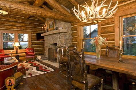 Small cabin ideas living room rustic with stone fireplace stone mantel fire screen
