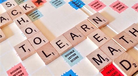 is de a scrabble word free photo scrabble education text read free image