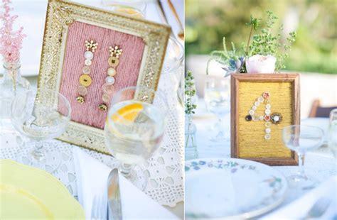 wedding reception table number ideas diy button table numbers diy wedding reception ideas onewed