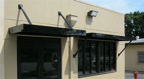 metal awnings for commercial buildings architectural canopies bahama shutters trinity fl