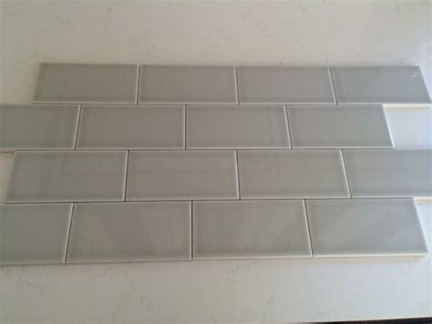 22 light grey subway white grout with decorative line go light or dark with grout color