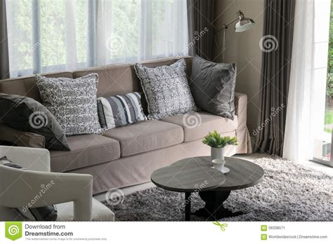 Brown Throws For Sofas by Brown Tweed Sofa With Grey Pillows Stock Photo Image