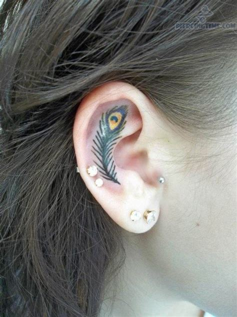 feather tattoo and dual lobe piercing